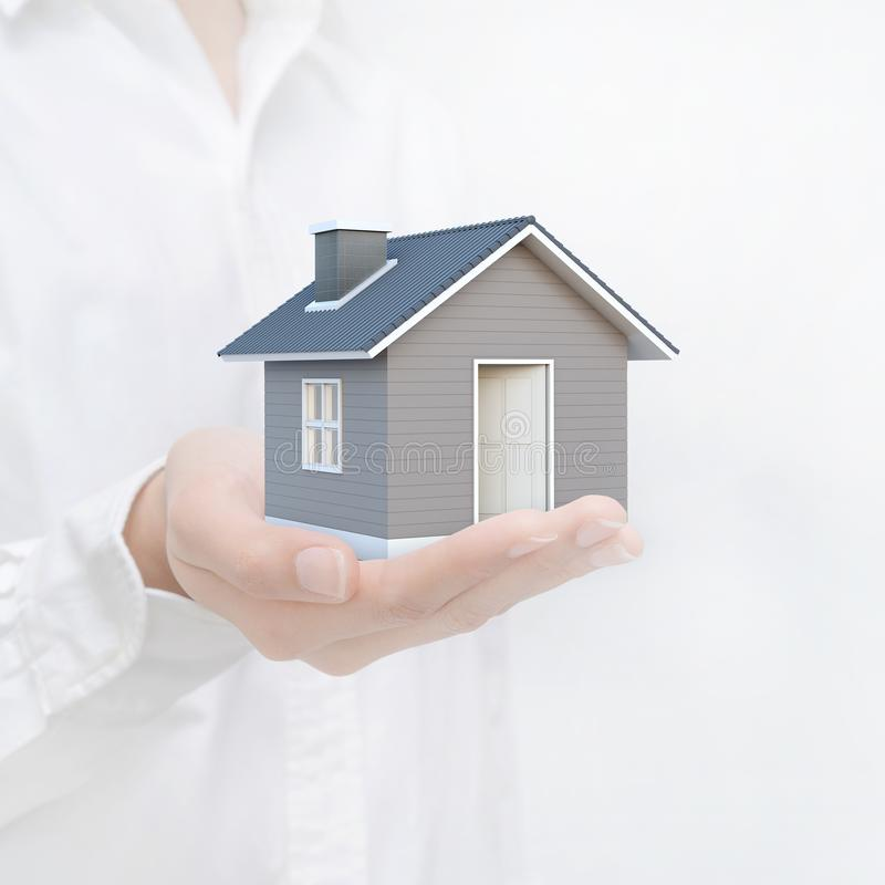 Simple house in human hands. Image idea of real estate and property concept. stock illustration