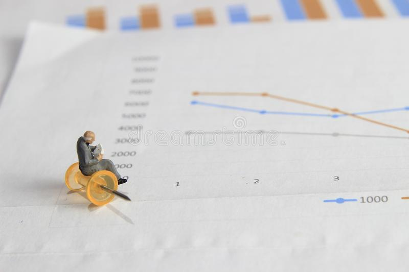 Simple Illustration Photo 1 Sitting Mini Figure old man Toy Reading Graphic Business Chart at transparent yellow push pin stock photos