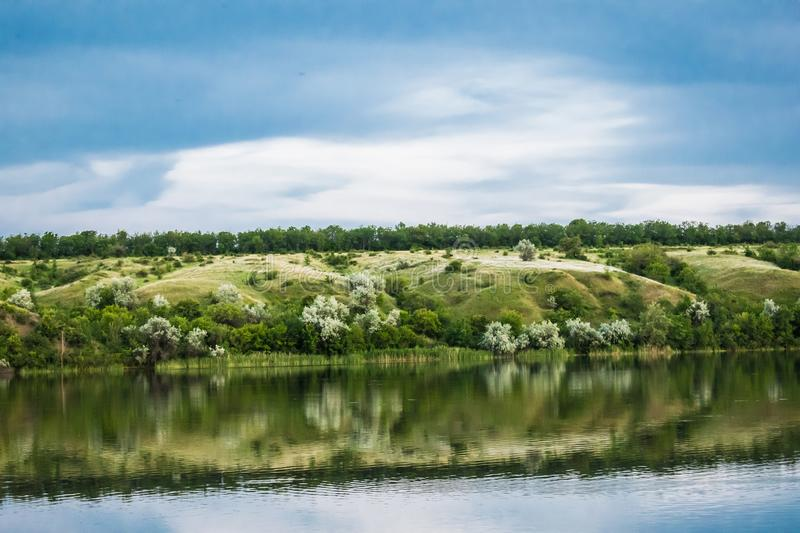 A simple landscape in the Rostov region in Russia, the river - Seversky Donets, Don. Spring is the beginning of summer. Green vege royalty free stock photo