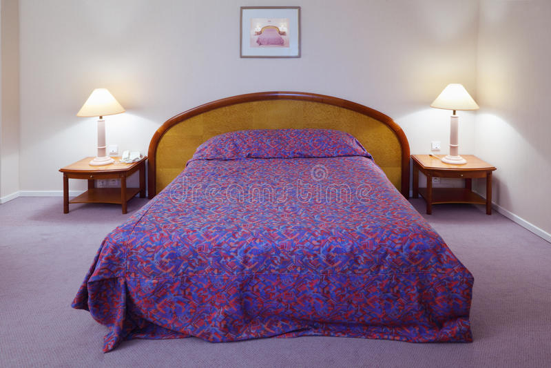 Simple light comfortable bedroom in hotel