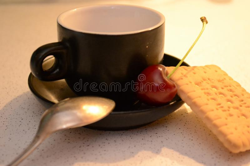 Evening Coffee, Cookie and Cherriy. The simple macro shooting of an evening coffee break. Ideal for website backgrounds, illustrations etc stock images
