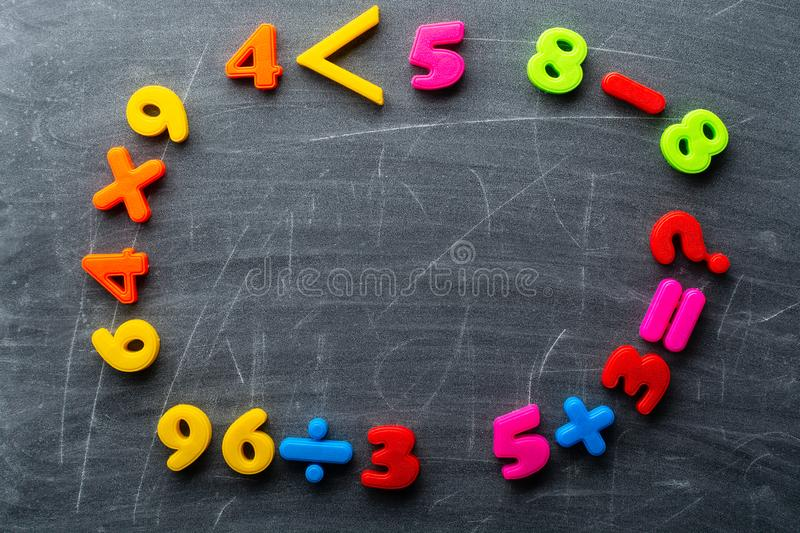 Simple math exercises lying on surface of clean blackboard royalty free stock images