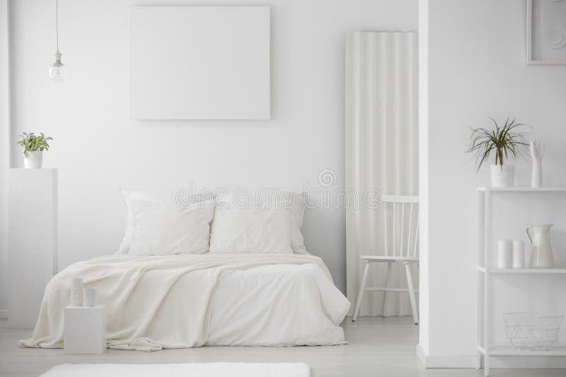 Simple, minimal, white bedroom interior royalty free stock photos