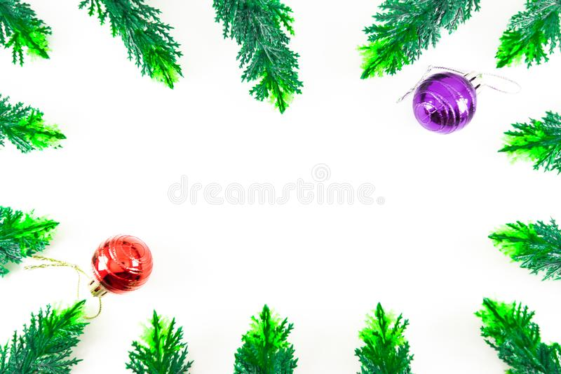 simple and minimalist christmas frame made by green plastic cypress leaves in white background stock photo