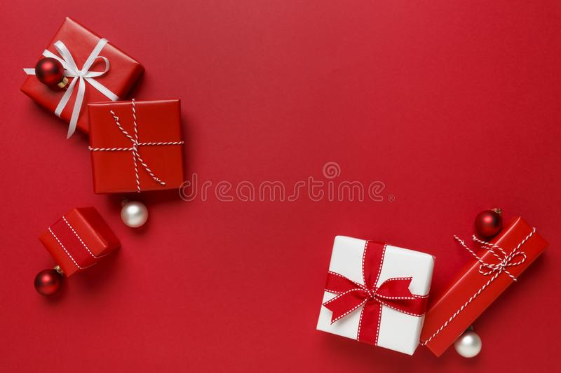 Simple, modern red & white Christmas gifts presents on bright red background. Festive holiday border. stock photos