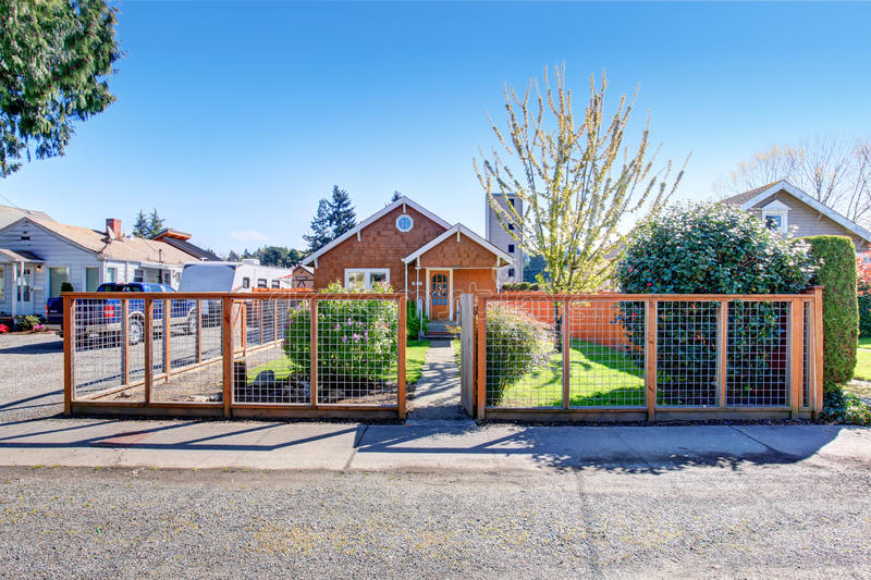Simple Notherwest home with fenced yard. stock images