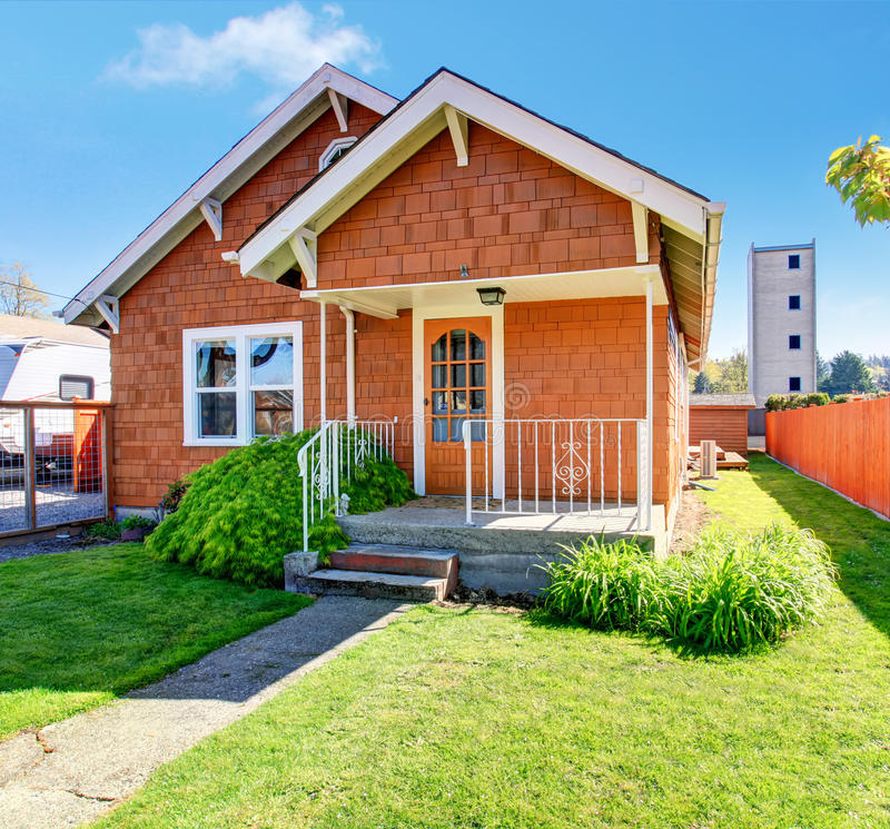 Simple Notherwest home with fenced yard. royalty free stock image