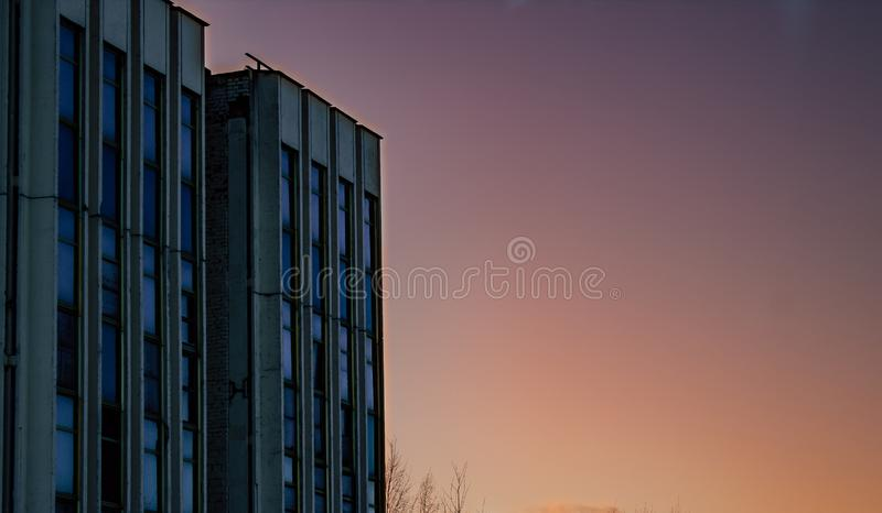 Simple Old Concrete Building Corner for Sale or Loan, Basic Minimal Shape Abstract Exterior Blue Sky and Cloud in Background with royalty free stock photo