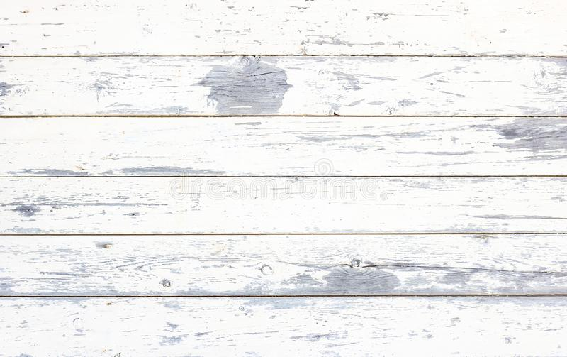 Simple old grunge rustic wooden texture background with white color cracked weathered paint and scratches. royalty free stock images