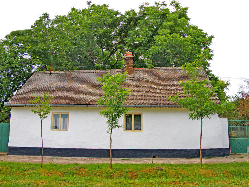 Simple old, traditional house with a white facade stock images