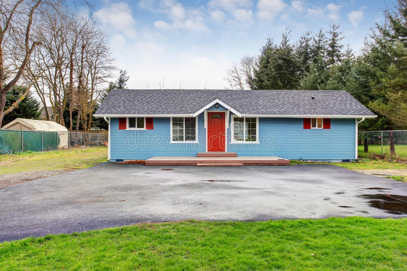 simple one story house exterior with blue and red trim stock image