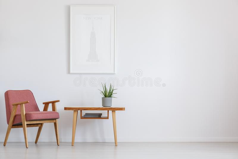 Pink chair next to table stock photography