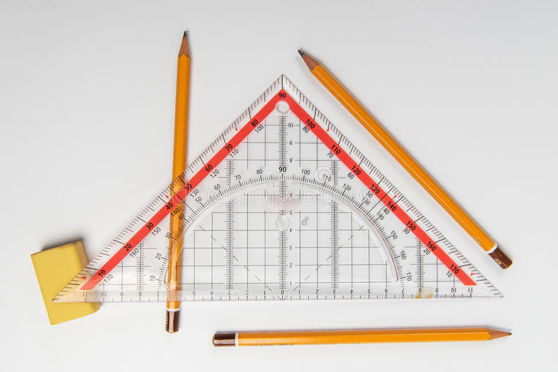 Simple pencils, eraser and ruler triangle stock images