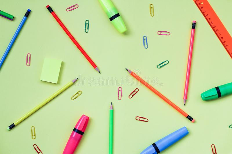Simple pencils, highlighters, neon paper clips. office supplies for study. Subject: back to school. the view from the top stock photography