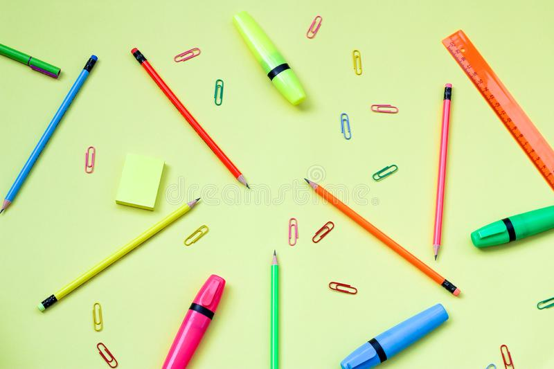 Simple pencils, highlighters, neon paper clips. office supplies for study. Subject: back to school. the view from the top stock photos