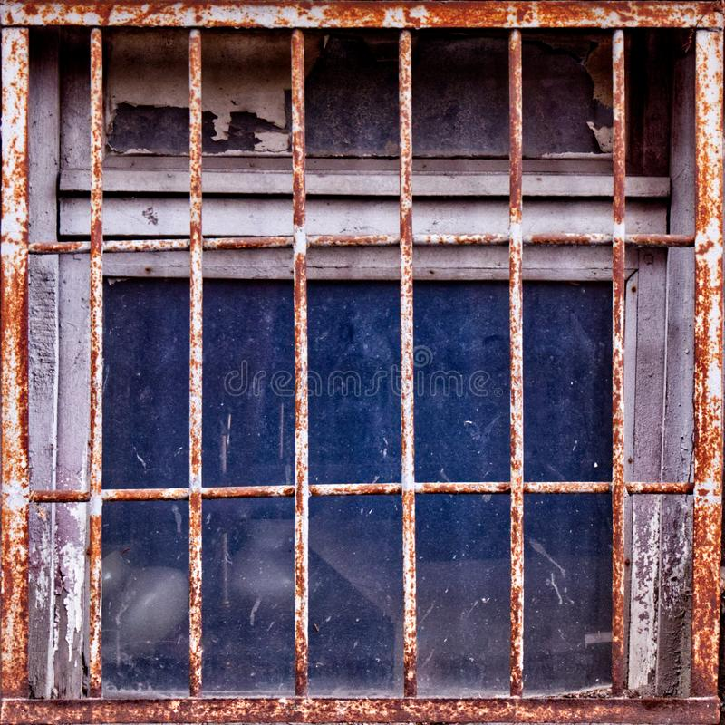 Simple photo background pattern of window with rusty shutters. Abstract image texture for designers with figured steel window shutters. Squared tile for texture stock photos