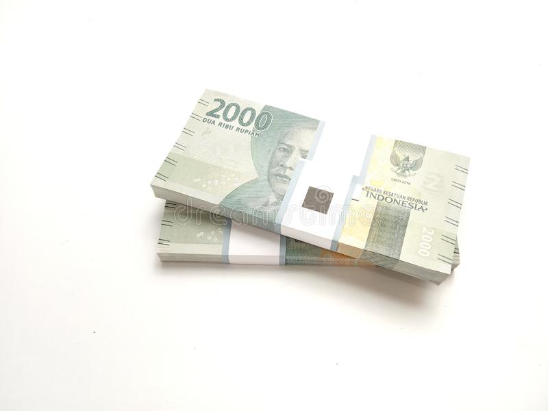 Simple Photo, Top View, Packs of Rupiah Indonesia Money, 2000, at white background stock photo