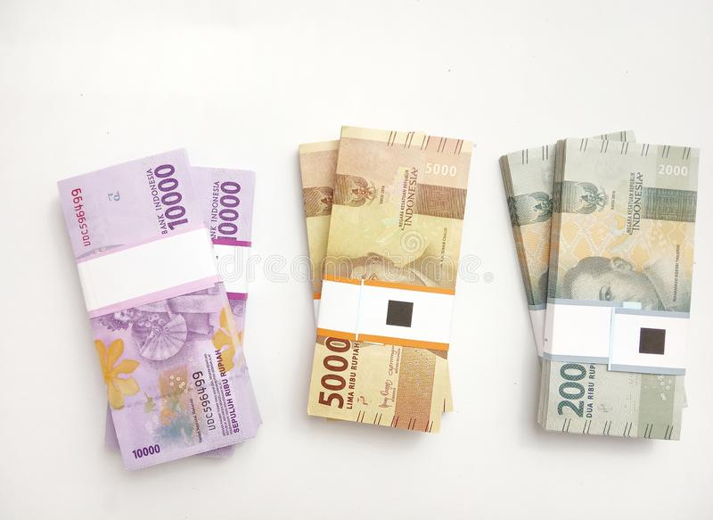 Photo Simple Photo, Top View, Packs of Rupiah Indonesia Money, 2000, 5000, 10000, at white background stock photos