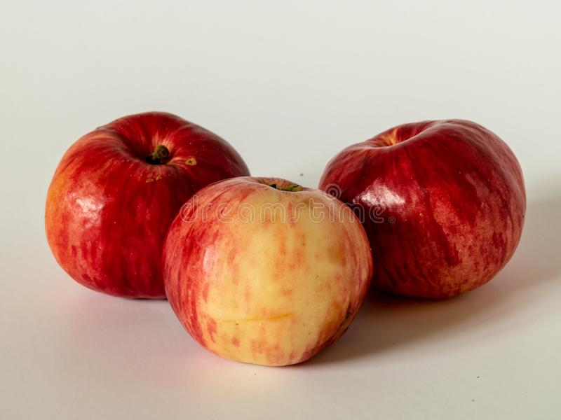Picture with red apples on a light background. Simple picture with red apples on a light background stock photos
