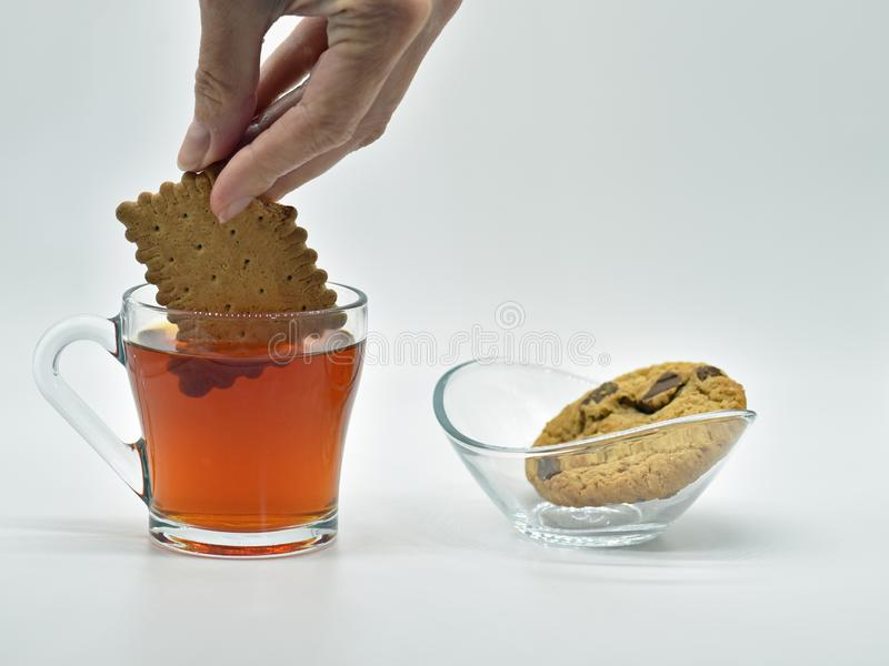 Simple pleasures dipping biscuit in tea. One of the simple pleasures in life is dipping biscuits in tea royalty free stock photography