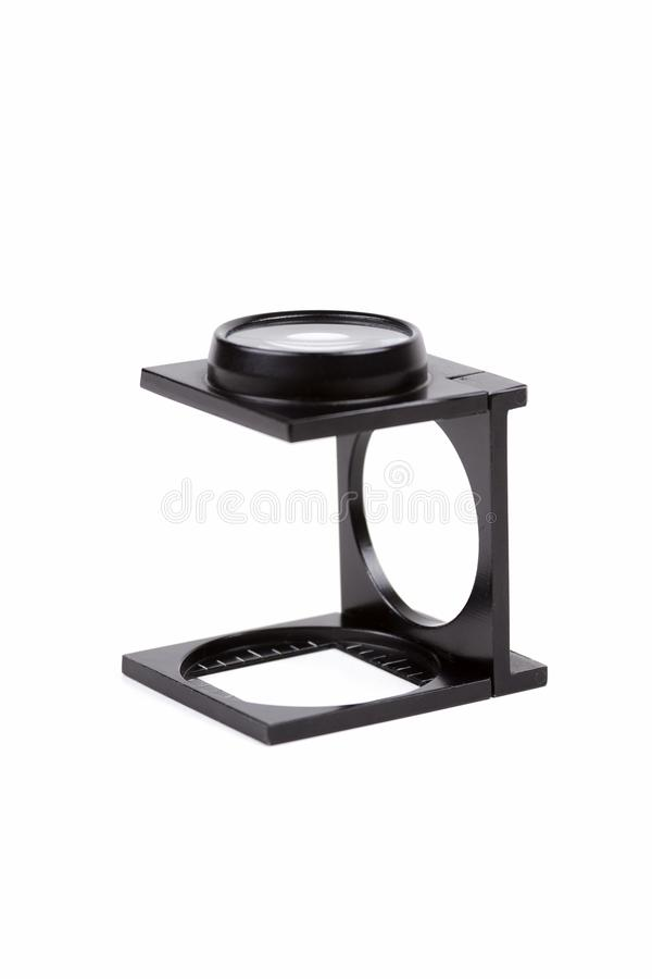 Simple pocket foldable linen testing stand magnifier, textile magnifying glass, thread counter, tool for line measurement. And inspection, professional workshop stock image