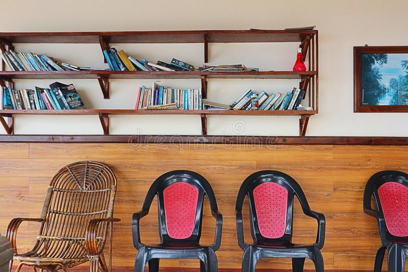 Simple reading room. Shelves with stock photography