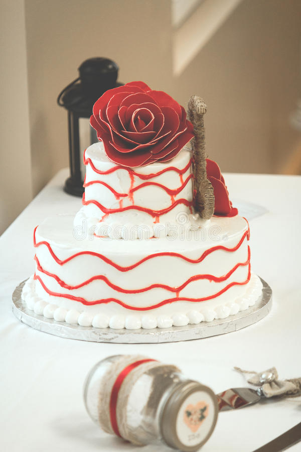 Simple red and white wedding cake with rose on top stock photo download simple red and white wedding cake with rose on top stock photo image of junglespirit Gallery