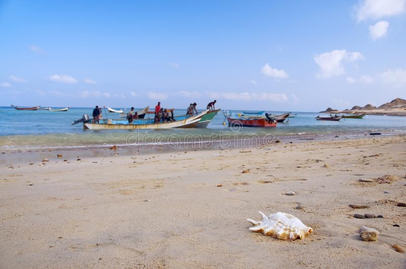 Simple rural fishermen are preparing for fishing. Boats in the water on the coast of the island in the Arabian Sea. island of Soco. Tra. Yemen royalty free stock photography