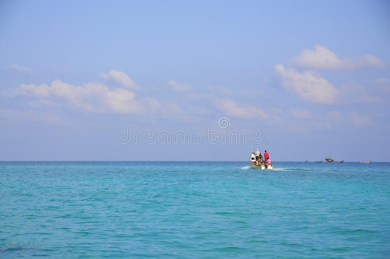 Simple rural fishermen are preparing for fishing. Boats in the water on the coast of the island in the Arabian Sea. island of Soco. Tra. Yemen royalty free stock image