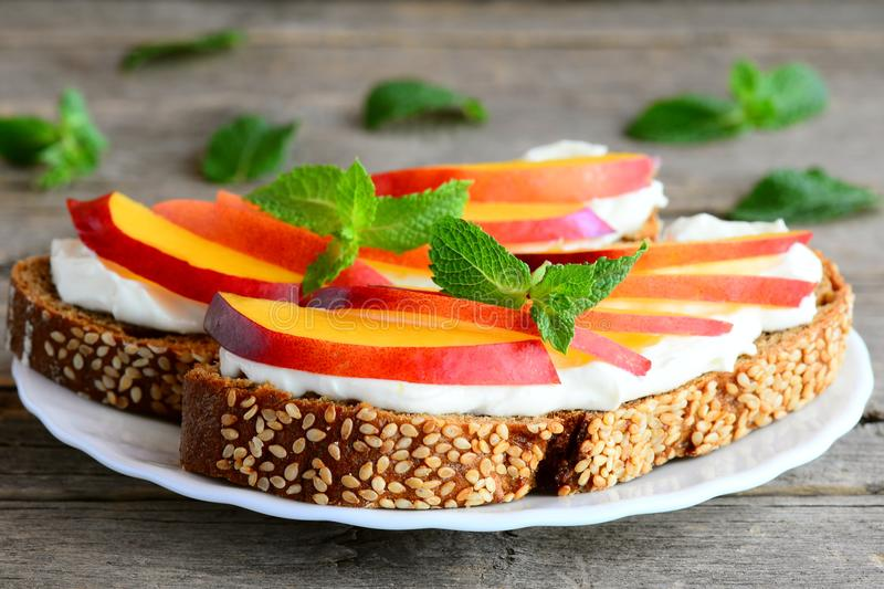Download Simple Sandwiches With Cream Cheese Fresh Nectarines And Mint On A Serving Plate And & Simple Sandwiches With Cream Cheese Fresh Nectarines And Mint On A ...