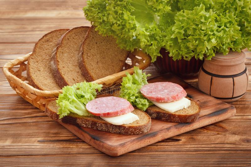 Simple sandwiches with smoked sausage and cheese royalty free stock photo