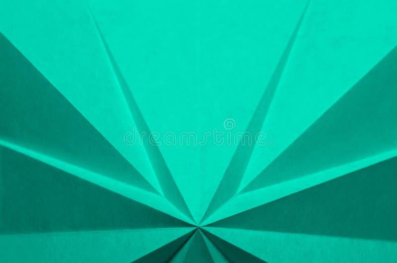 Simple, sarcelle d'hiver, fond abstrait monochrome d'origami photographie stock