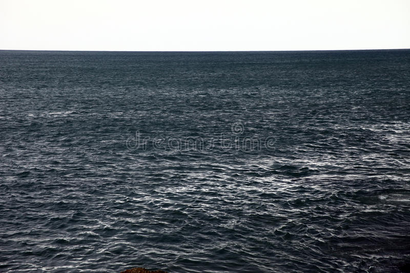 A simple shot of dark sea water royalty free stock image