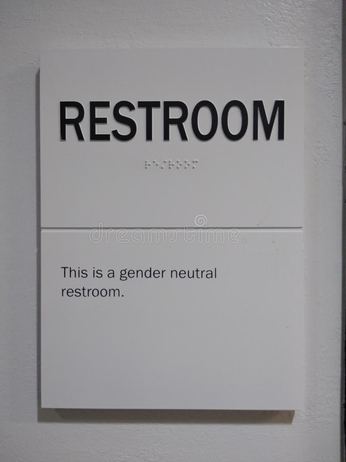 Gender Neutral Restroom, Public Bathroom, Braille. Simple sign indicating this as a gender neutral restroom. This photo was taken in New York City on September stock photos
