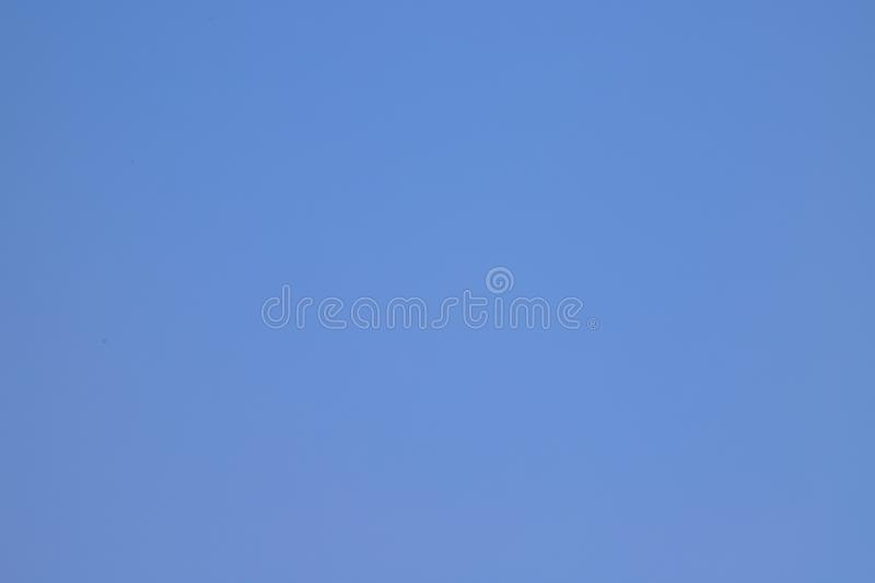 Simple smooth clean light blue background. An ideal image of a blue surface, the color of the sky. Abstract tender background. With copy space for text stock photography