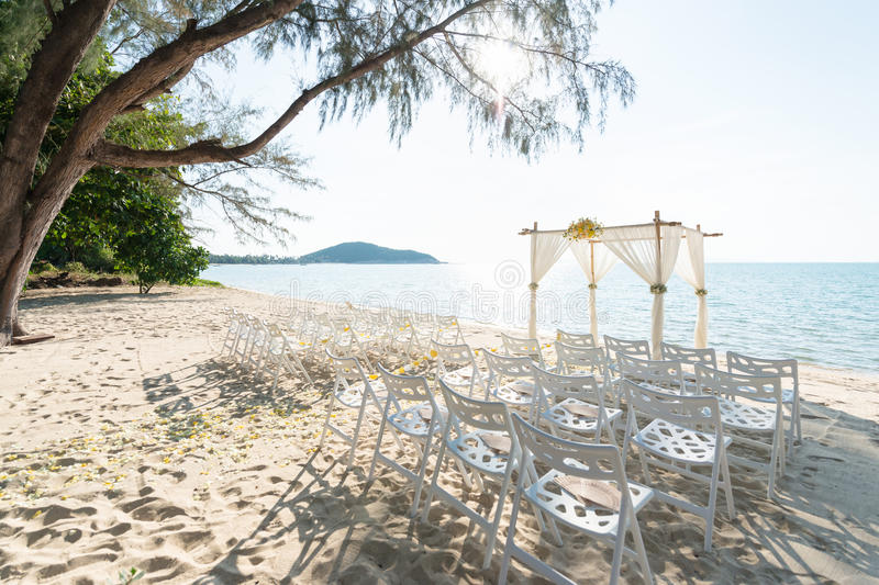 Simple style wedding arch and decoration, venue, setup on tropic stock images
