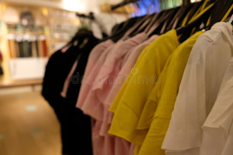 Simple t-shirts on a store royalty free stock photos