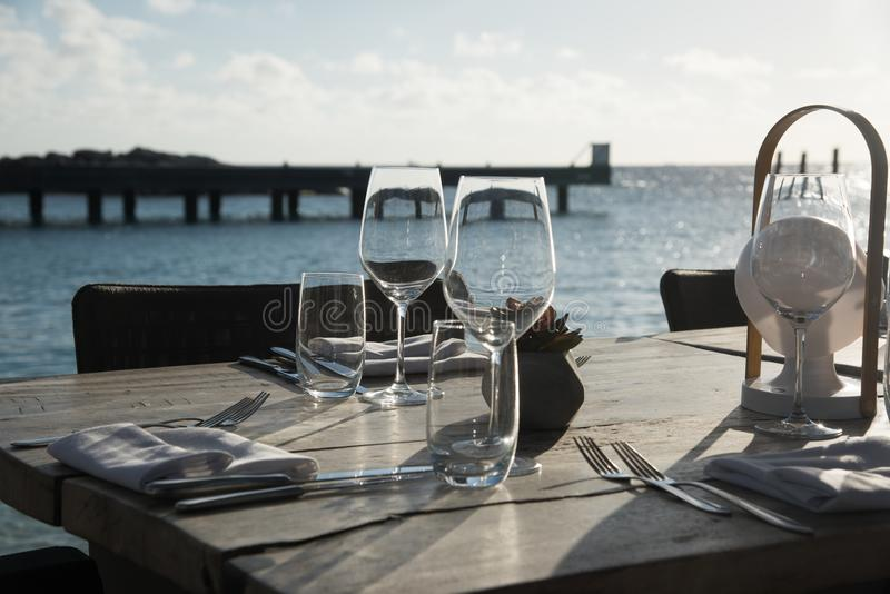Simple outdoor restaurant table setting royalty free stock photography