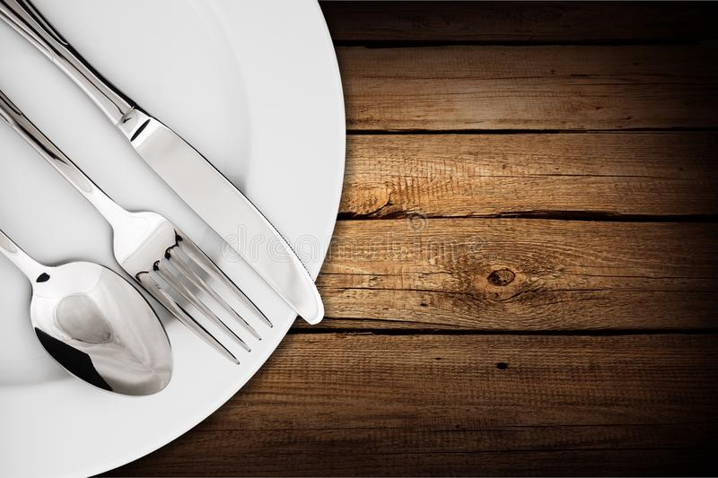 Simple table setting on wooden background stock photos