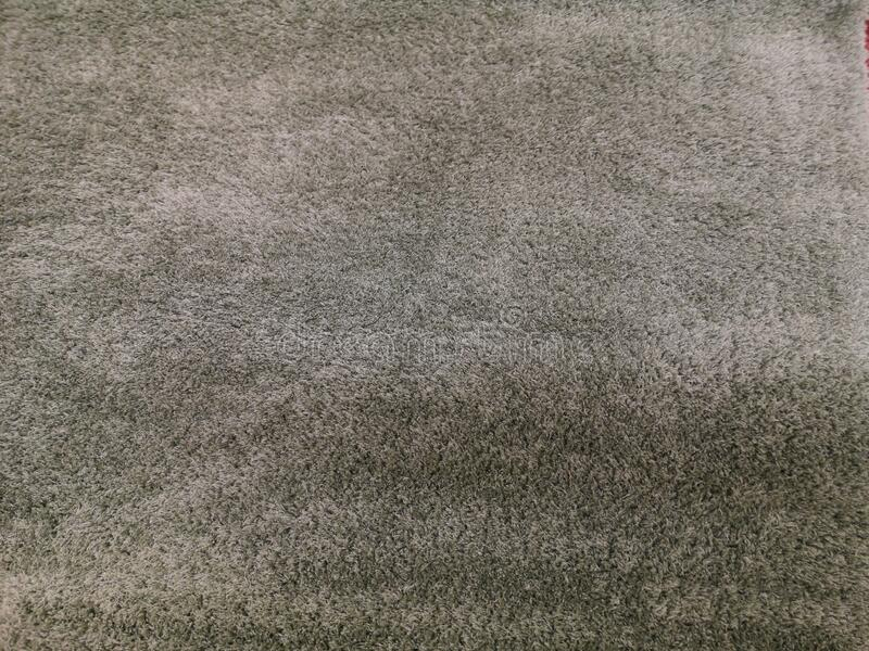 Simple texture of gray carpet with elements of thick wool.  stock photography