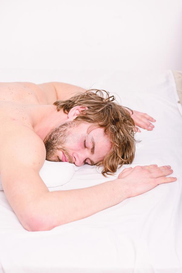 Simple tips to improve your sleep. Man unshaven bearded face sleep relax or just wake up. Guy bearded macho relax in. Morning. Total relax concept. Man stock photography
