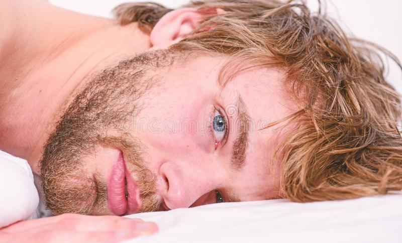 Simple tips to improve your sleep. Total relax concept. Man unshaven bearded face sleep relax or just wake up. Guy. Bearded macho relax in morning. Man stock photography