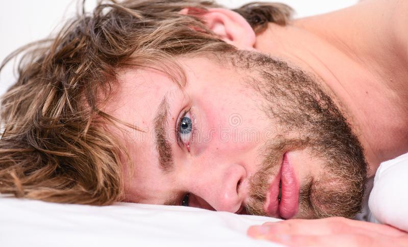 Simple tips to improve your sleep. Total relax concept. Man unshaven bearded face sleep relax or just wake up. Guy. Bearded macho relax in morning. Man stock image