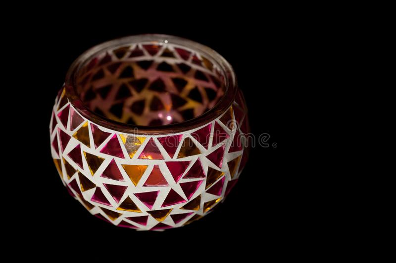 Simple traditional art and craft tealight candle holder bowl. Simple traditional art and craft tealight candle holder. Decorative bowl with triangles of colored royalty free stock photography