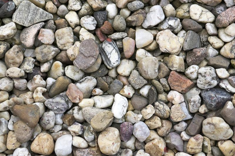 Simple ugly and grey stones, one by one. Gravel, pebbles background royalty free stock photos