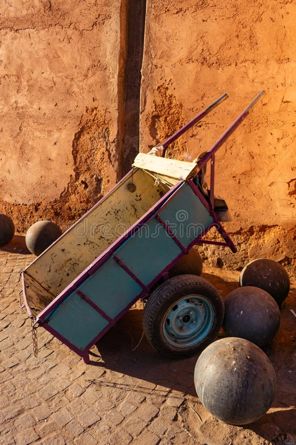 Wheeled Cart beside a Wall on the Streets of Marrakesh Morocco. A simple wheeled cart beside an old stone wall on the streets of Marrakesh Morocco royalty free stock photo