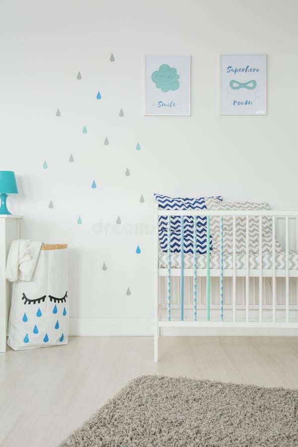 Simple, white baby bedroom stock photo