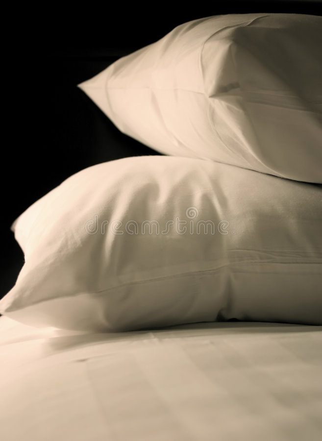 Simple White Bed royalty free stock photos