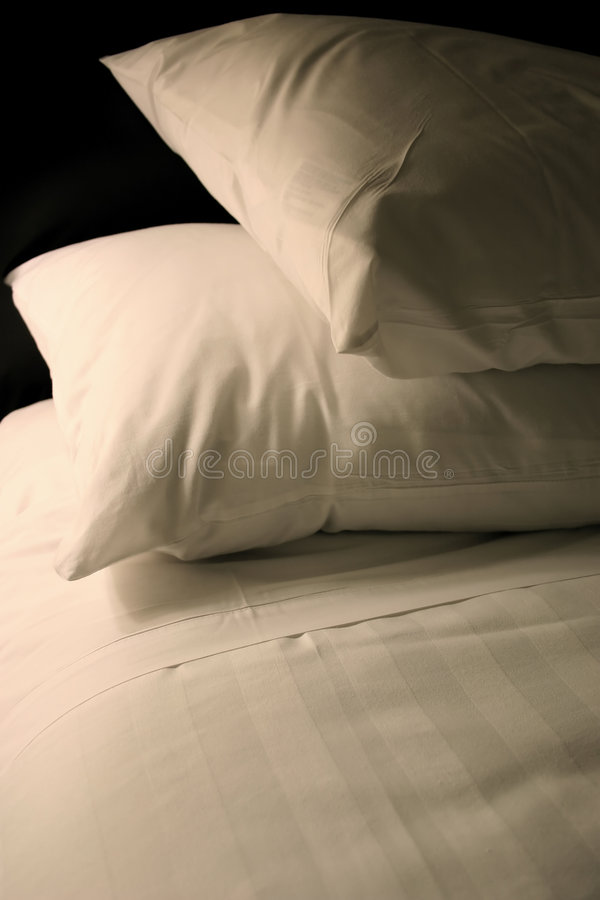 Simple White Bed stock photo