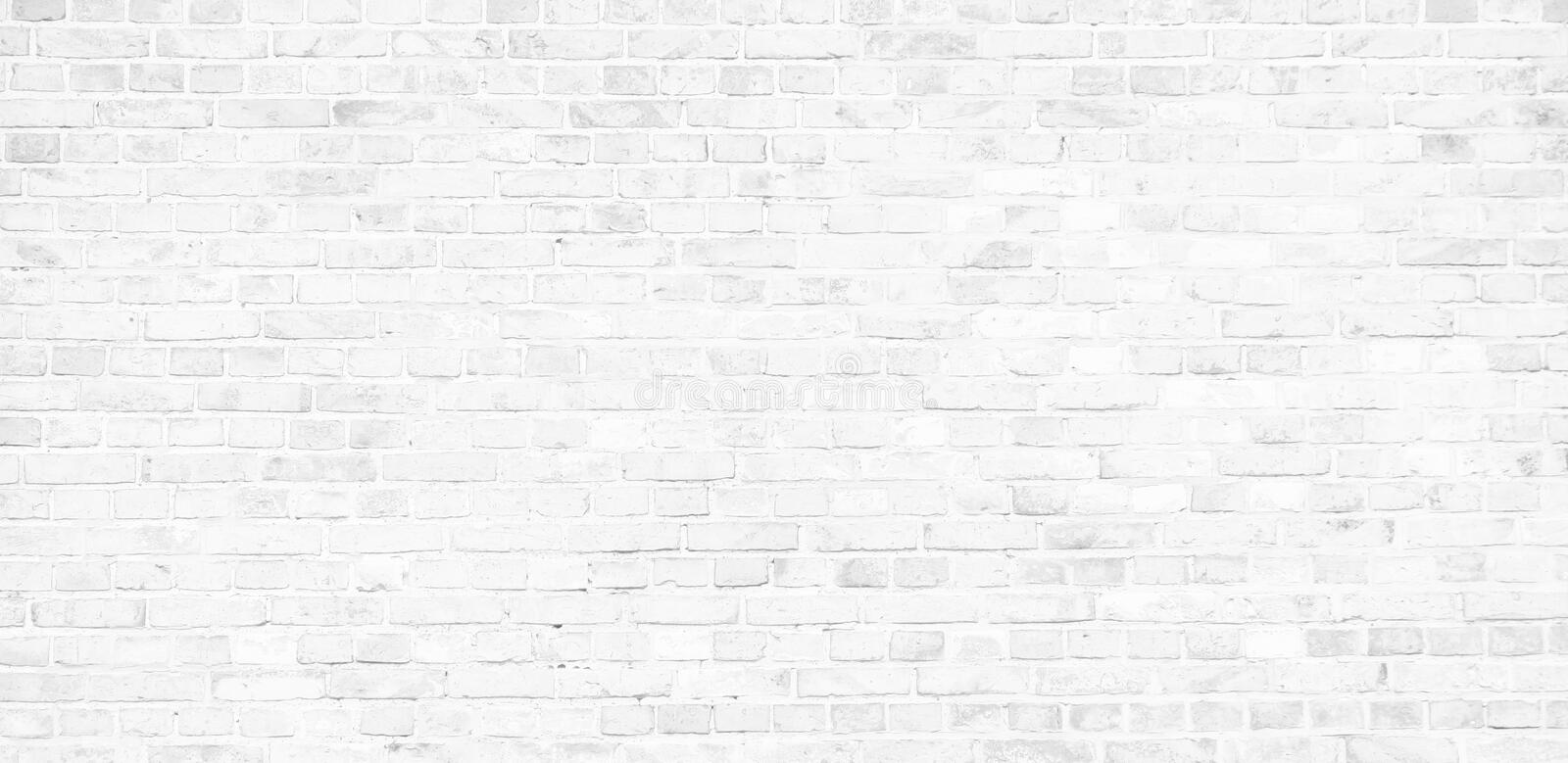 Simple white brick wall with light gray shades seamless pattern surface texture background in banner wide panorama. Format royalty free stock image